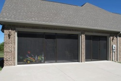 Pricing it 39 s not just a screen door it 39 s a for Retractable double garage door screen